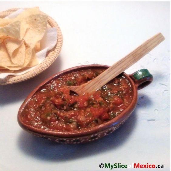 Cooked Mexican Sauce with chips logo