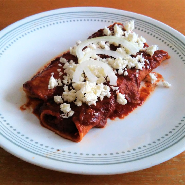Basic red enchiladas with cheese and onions