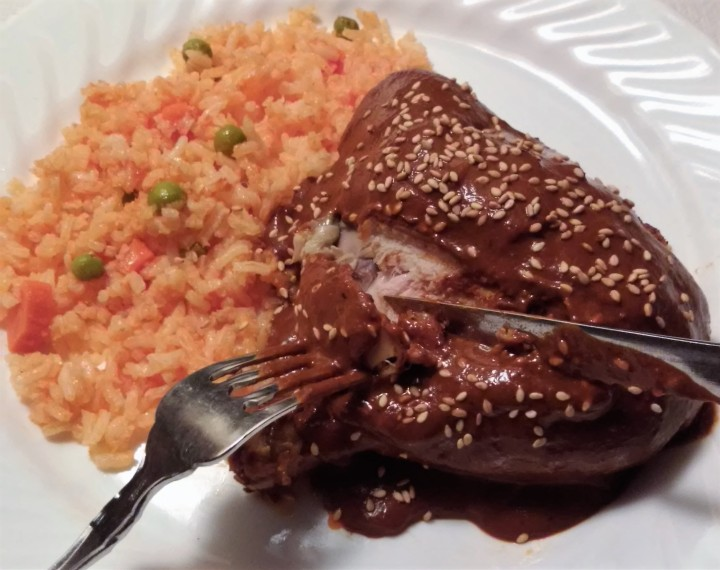 003 chicken in red mole with mexican style rice