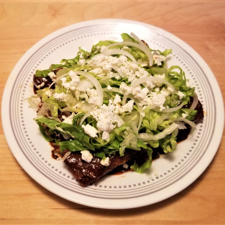 007 mole enchiladas with lettuce