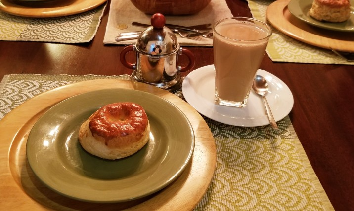 "Bisquet and café con leche in glass cup from ""Bisquets Obregón"" (Mexico City 2019)."